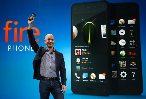 Amazon CEO Jeff Bezos holds up the new Amazon Fire Phone at a launch event on June 18, 2014, in Seattle. (photo: Ted S. Warren—AP)