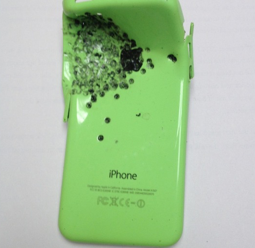 The victim's mobile phone took the majority of the blast from the shotgun. (photo: Cheshire Police)