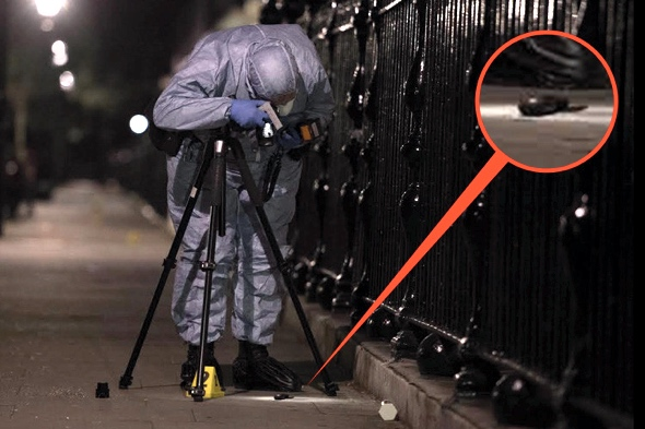 A forensic officer examines what is believed to be the knife used in the attack last night (photo: The Sun)