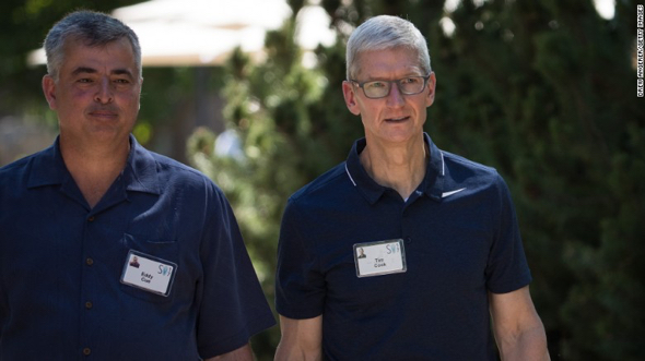 Apple CEO Tim Cook, right, walks with Eddy Cue, Apple's senior vice president of internet software and services, at the Allen & Co. Sun Valley Conference on Wednesday, July 12