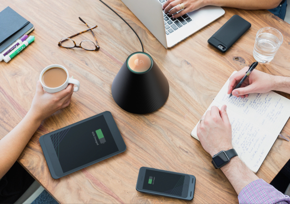 Pi power platform charges up to 5 devices at once, up to approximately one foot away