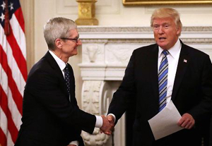 Apple CEO Tim Cook and U.S. President Donald Trump at tech summit in June