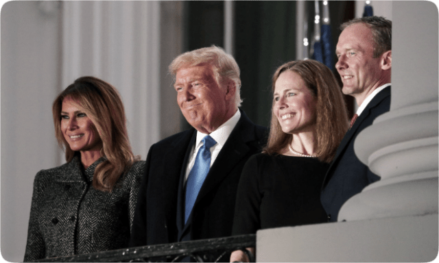 U.S. President Donald Trump, with First Lady Melania Trump stands with Amy Coney Barrett and her husband Jesse Barrett on the balcony of the White House on October 26, 2020. (photo: Tom Brenner/Reuters)