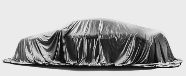 Tim Cook drops some hints on Apple's vehicle plans. Image: vehicle under wraps