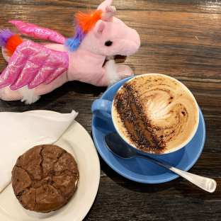 Unicorn toy, coffee in mug, choc Butterbing