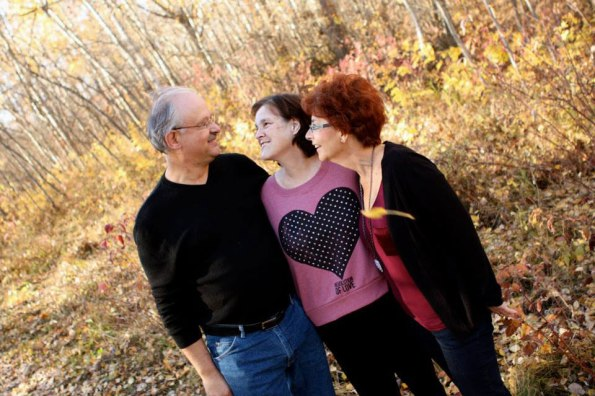 Dorothy's photographed with her parents Judy and Henry outdoors in fall conditions.