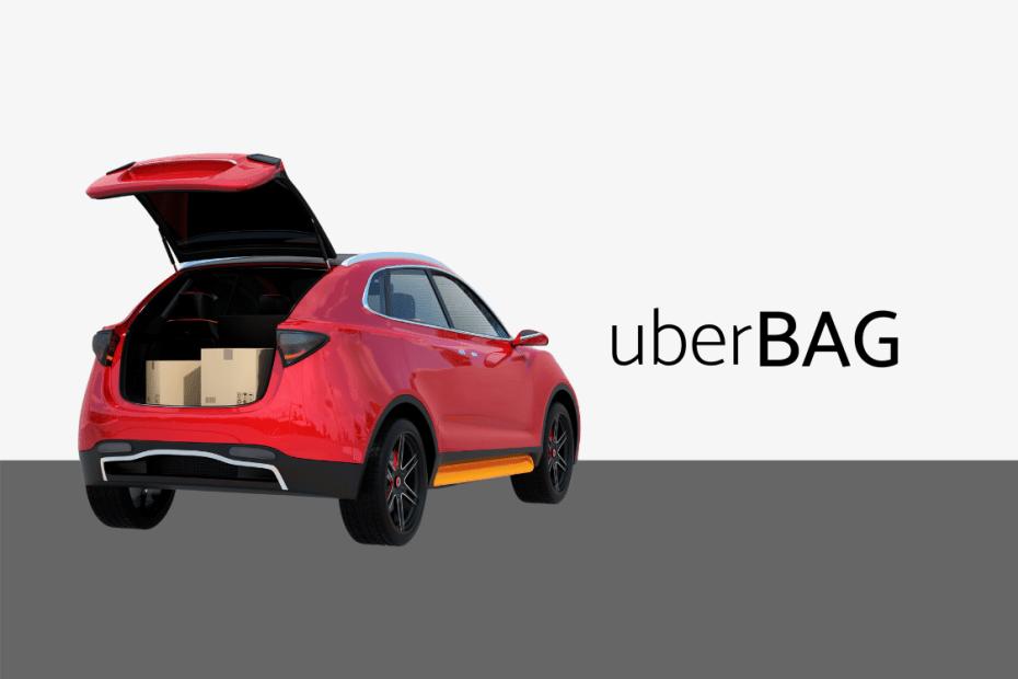 carro vermelho com o porta malas aberto com 2 caixas