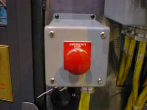 Old spring-return type of e-stop button with a plain red background legend plate.