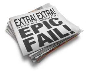 "Newspaper showing ""EPIC FAIL"" headline"