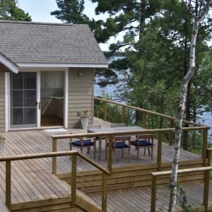 Clapboard cottage Lake of the Woods MacKneson Design Inc