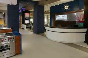 Sub Zero Wolf Design Center Front Desk with thermoformed Corian and Multi-colored LED