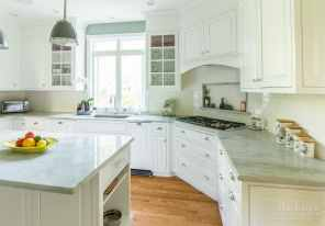 Sea Pearl Quartzite Marble Coutnertops with White Cabinetry and Sage walls