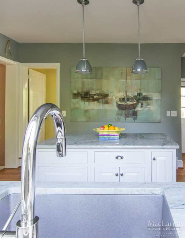 This nautical inspired Kitchen was matched around a custom painting adjacent to the sink