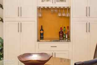 Pantry Wall with Beverage Center and Dry Bar featuring a Custom Wooden Hanging Stemware Rack