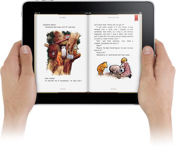 Mãos segurando iPad com iBooks aberto