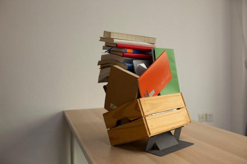 MOFT sustentando livros