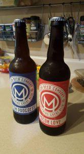 Macon Progress and Macon Love bottles