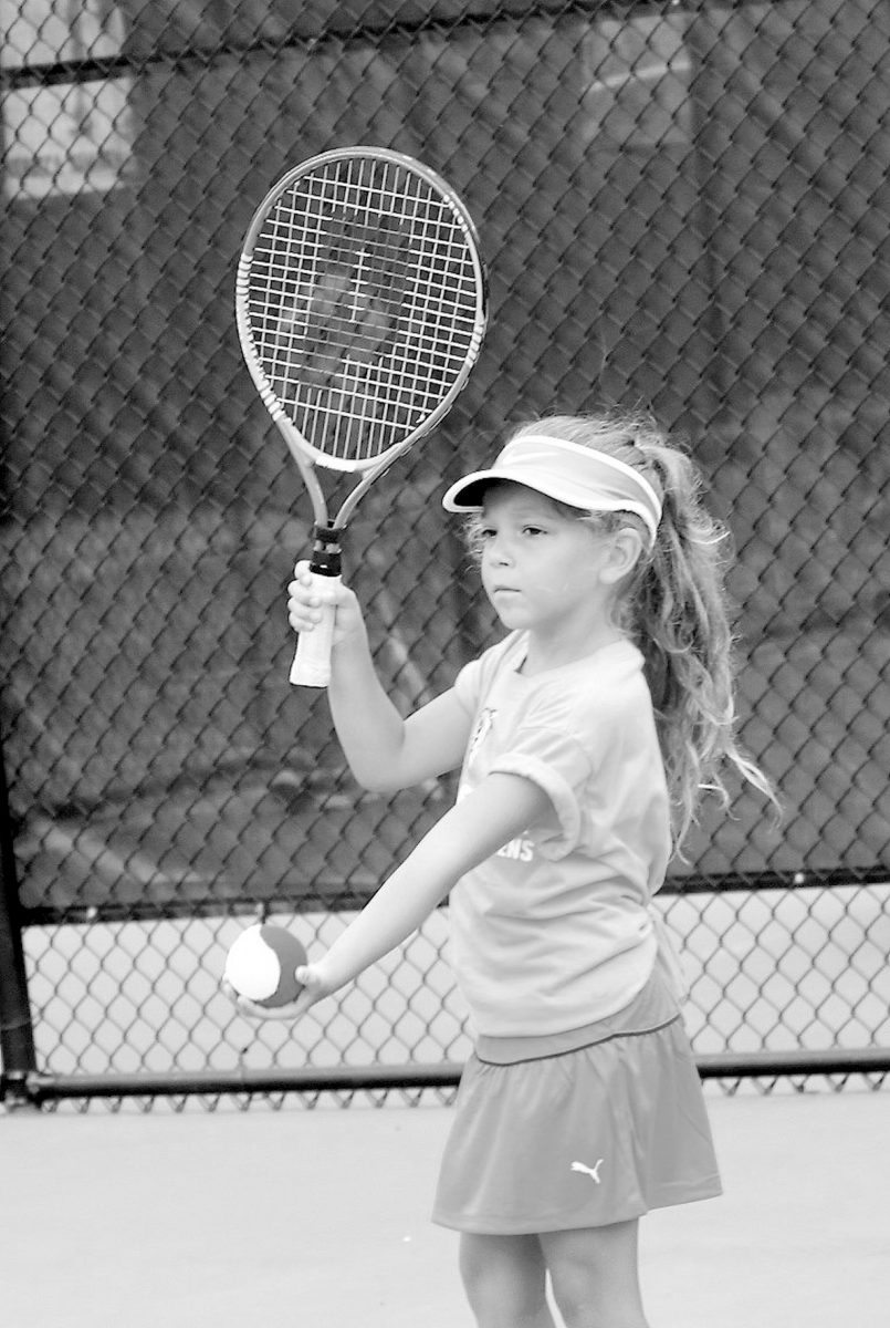 Tattnall Tigers Junior Team Tennis player Carsyn Conn preparing to serve. Photo courtesy Robin Bateman.