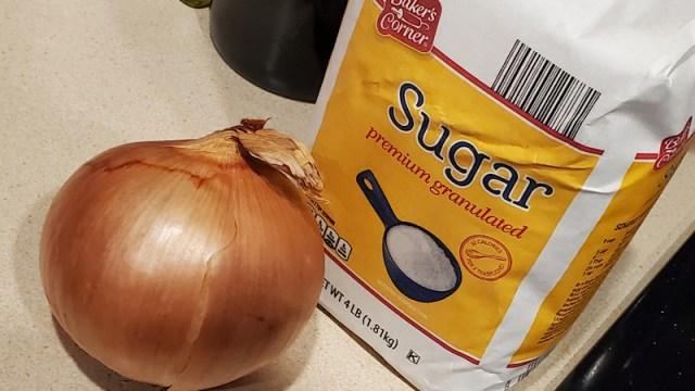 A whole onion and sugar