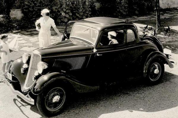 1933 Ford Deluxe Five Window Coupe women and child