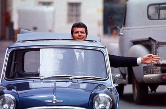signaling a turn in his Radford Mini Cooper