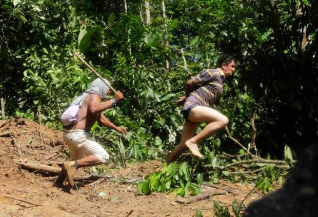 A Ka'apor Indian warrior chases a logger who tried to escape in the Alto Turiacu Indian territory