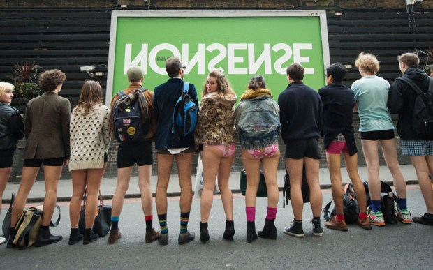 "People pose for a photograph before taking part in the annual ""No Trousers On The Tube Day"" event in central London on January 11, 2015. Originally started in the US, the international event, also known as the ""No Pants Subway Ride"" was created by improvisation group ""Improv Everywhere"" and sees people taking train journies while wearing no trousers, yet acting as normally as possible. AFP PHOTO / LEON NEAL"