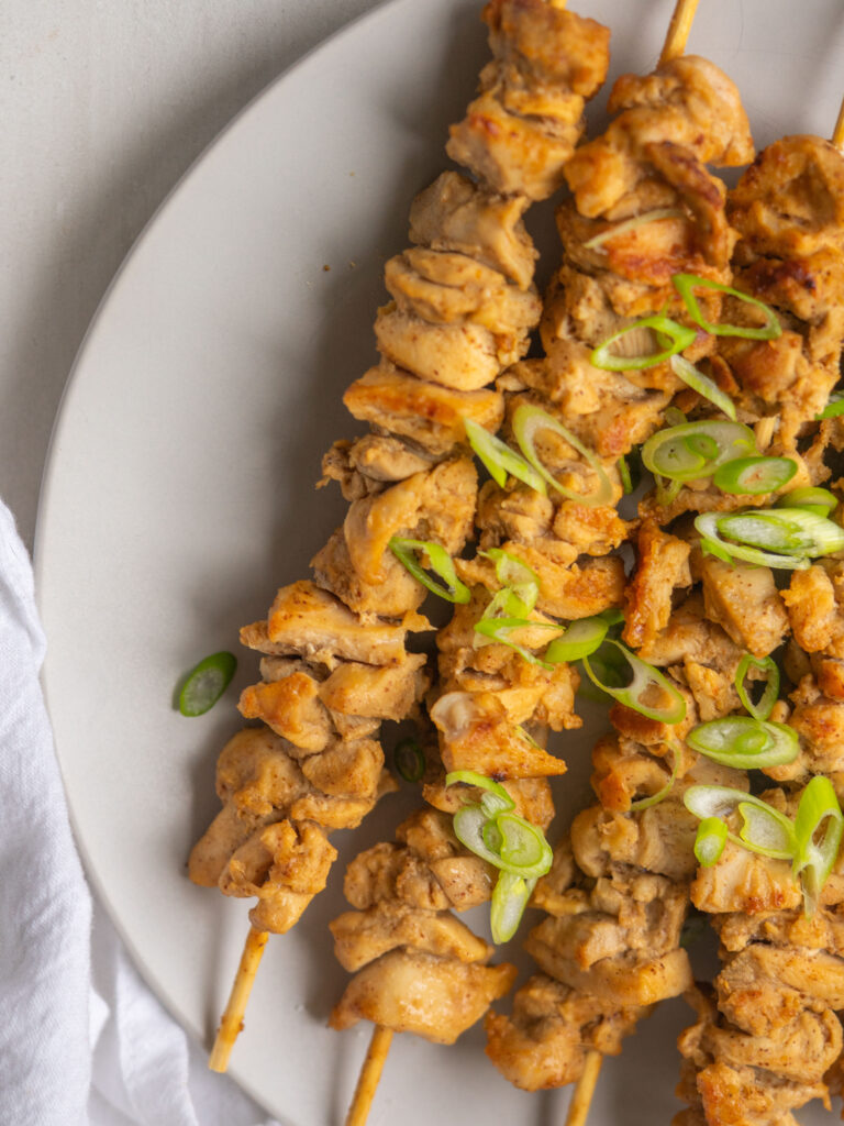 Above view of cooked whole30 chicken satay with green onions on top