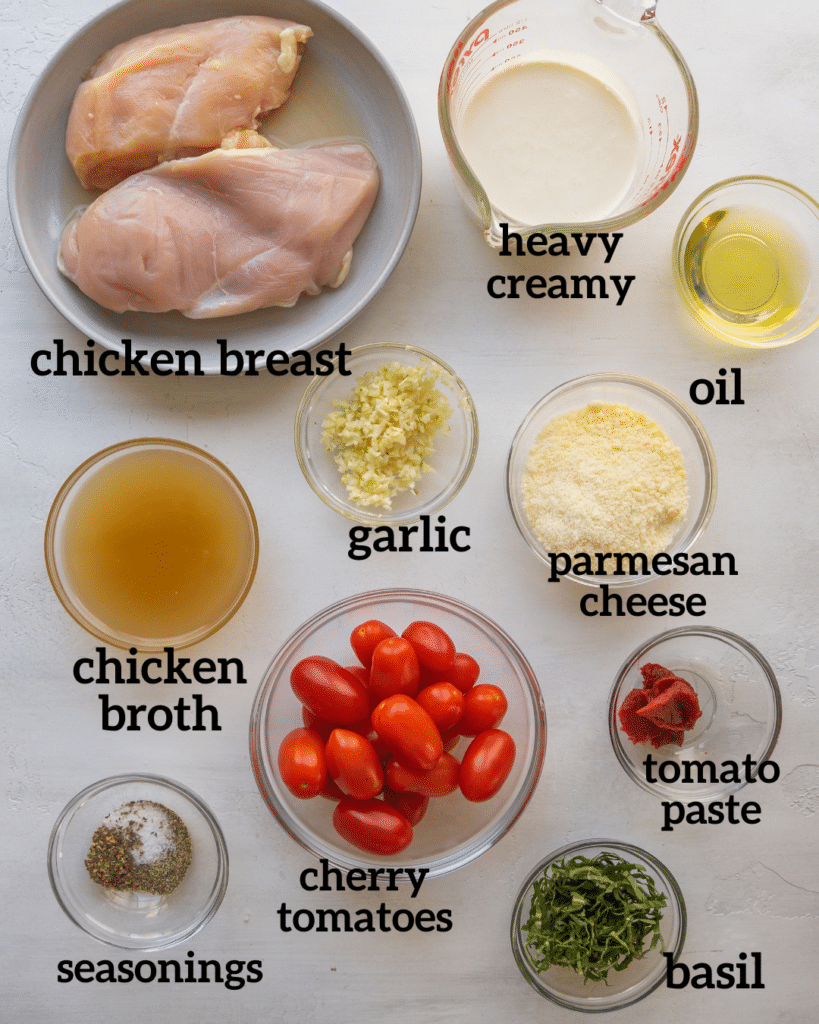 Above view of ingredients for tomato basil chicken recipe