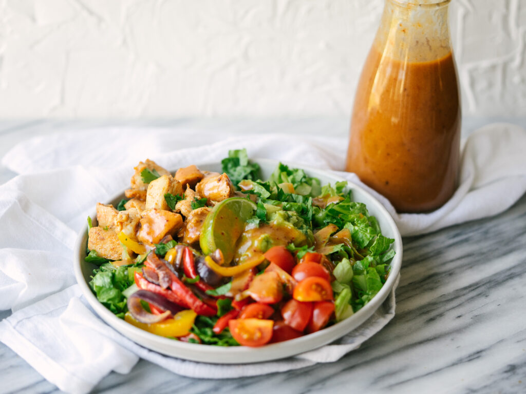 Healthy Chipotle salad topped with the honey chipotle vinaigrette