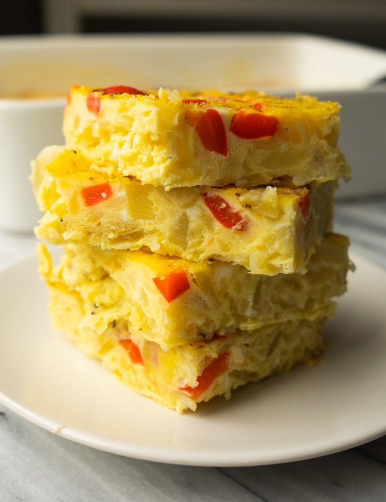 Side view of slices of hashbrown breakfast casserole on a plate