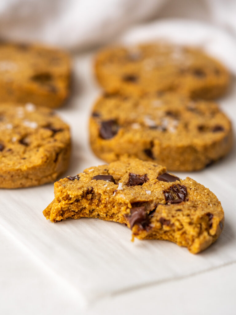 Three quarter view of slice and bake cookies on a tray with a bite out of one of the cookies