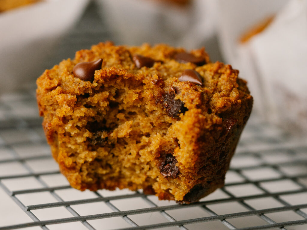 Side view of almond flour pumpkin muffins on a cooling rack