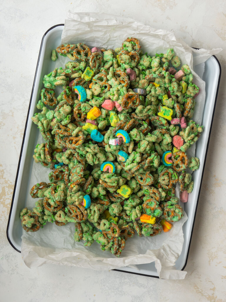 Above view of a green Leprechaun snack mix on a baking sheet with parchment paper