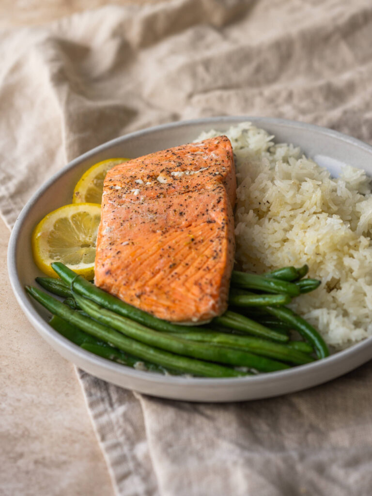 three quarter view of salmon and rice recipe on a plate