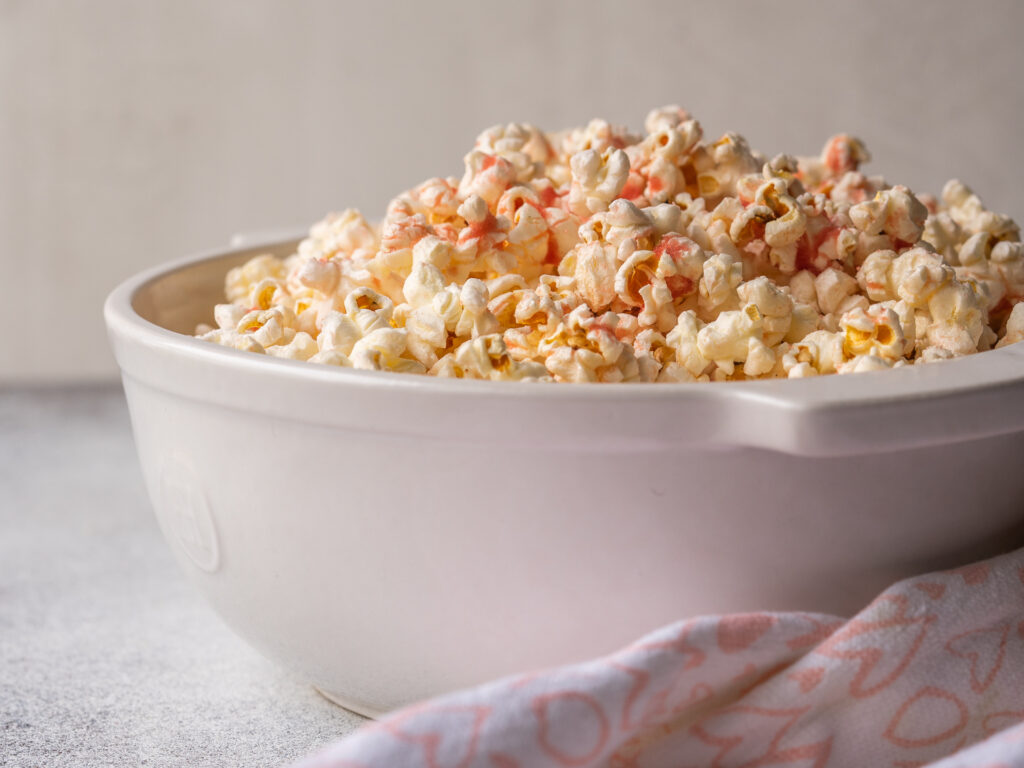 side view of a bowl of stove top popcorn