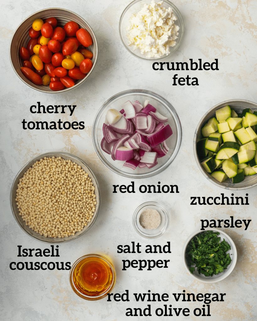 Above view of ingredients for making veggie couscous salad