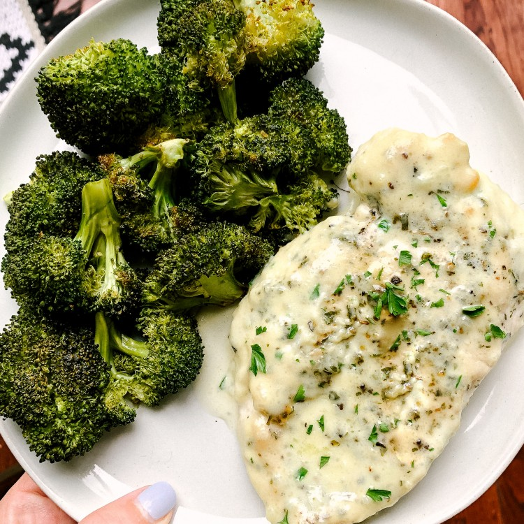 Above view of one pot chicken alfredo recipe served on a plate with roasted broccoli