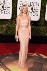 Kate Hudson: vestido de Michael Kors Collection, joyas de Forevermark y cartera de Jimmy Choo