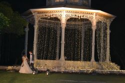 gorgeous lights, gazebo, and couple..