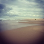 One person on a cloudy beach