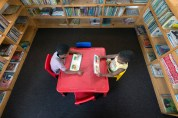 Two children in the library.