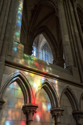 """Colourful light cast by the stained-glass windows in the """"Chapelle de Jean d'Arc."""""""