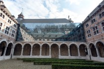 """The courtyard in the """"musée de la vie wallonne"""" (Museum of Wallon life) reflecting the hills behind it."""