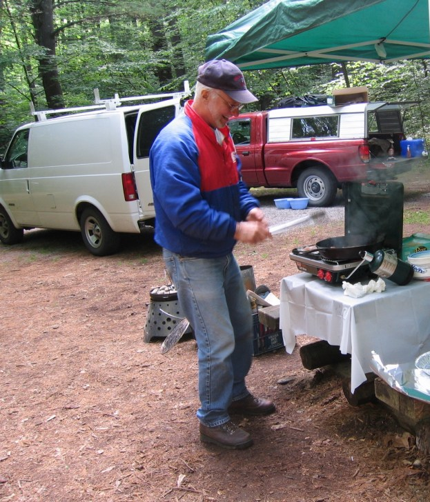 The Camp Commander, cooking the bacon