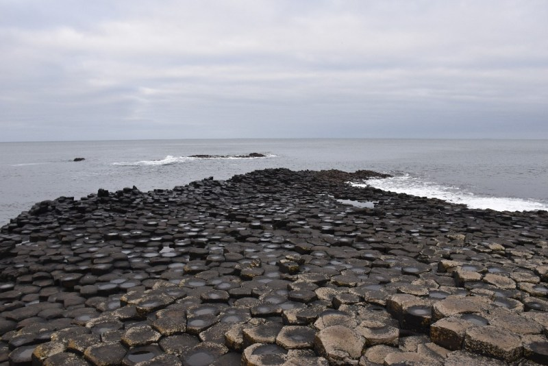 Taking a Nap in a Giant's Shoe in Giant's Causeway, Northern Ireland
