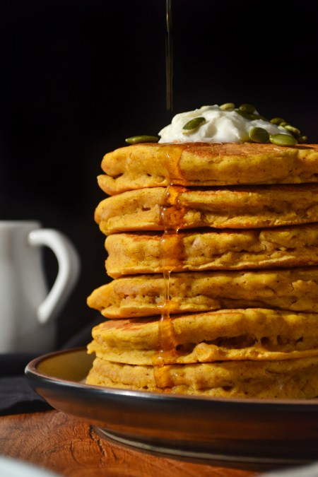 Fluffy pumpkin spice pancakes with maple syrup