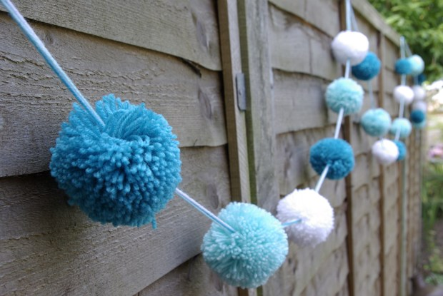 Blue and white pop pom bunting for a Frozen themed party