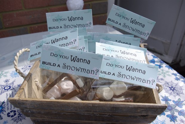 Frozen party ideas. Build your own snowman party favours, containing marshmallows and chocolate Matchmakers.