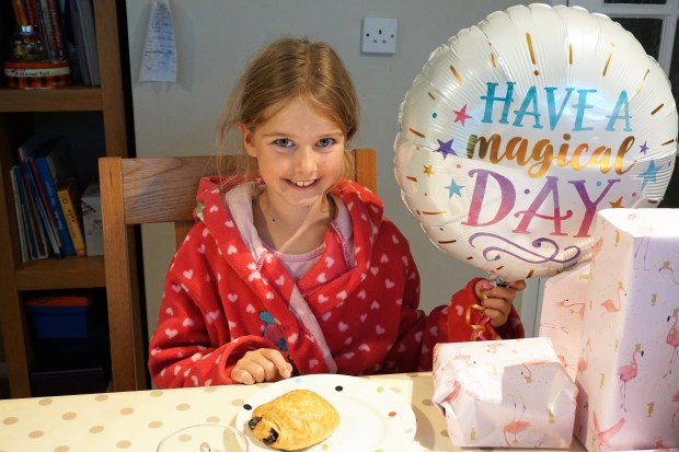 Girl holding a balloon.  How to make December birthdays special. Made By me Craft Parties